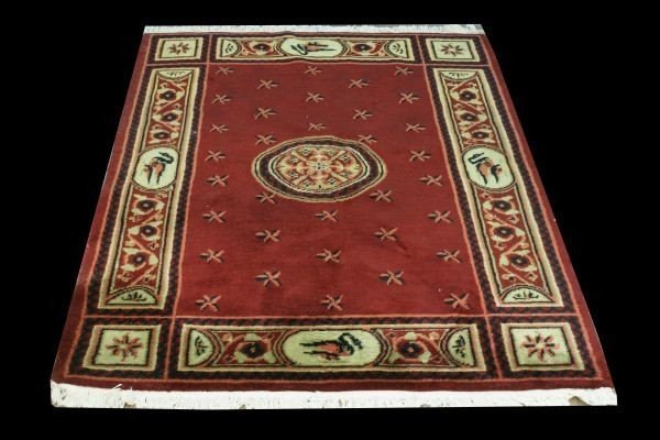 20D: SMALL ARE RUG IN OLIVE, EBONY IN A PLUM BACKROUND
