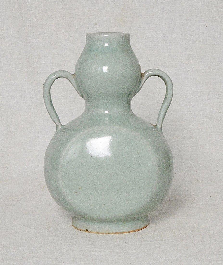 Chinese Celadon Glaze Porcelain Vase With Handle