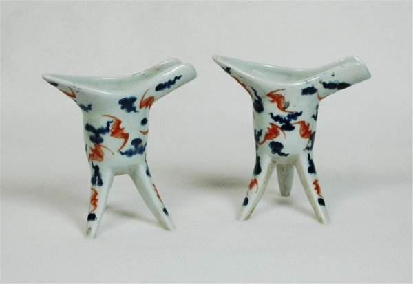 7020: Pair of Blue and White with red Porcelain Wine Cu
