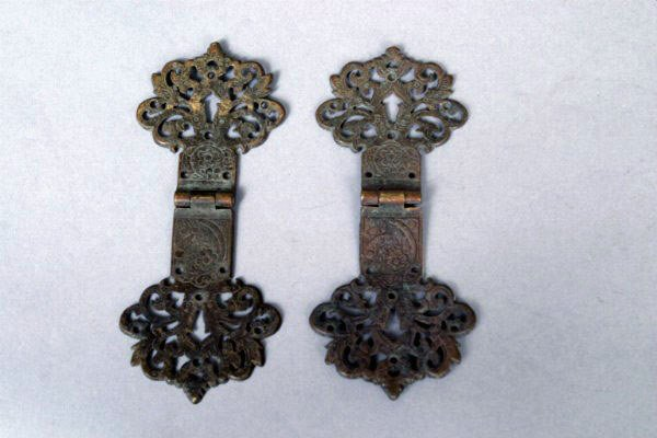 9: Two Strapwork Hinges