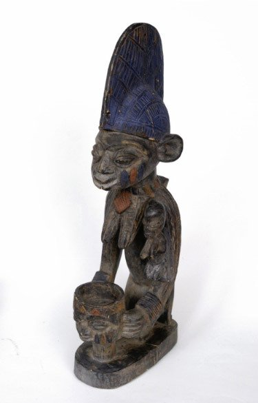 11: Carved African Fertility Figure