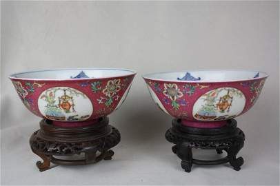 3100: A Pair of Ruby Ground Famille-rose Bowl