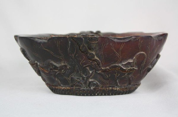 6021: Horn Libation Cup with archaistic Design