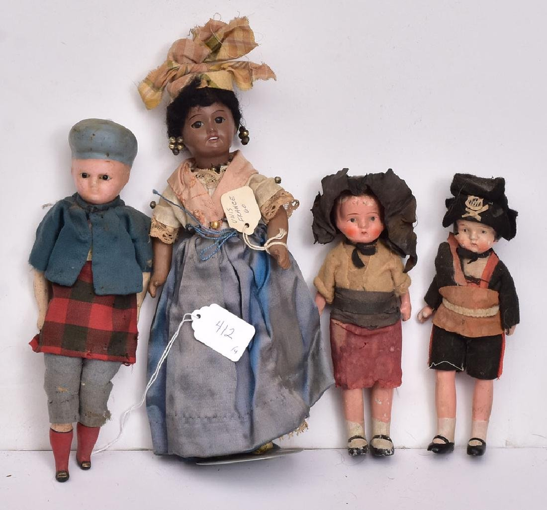 Group of Four Dolls