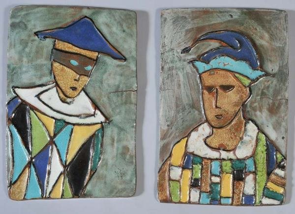 21: PAIR GLAZED POTTERY PLAQUES with harlequins each 13