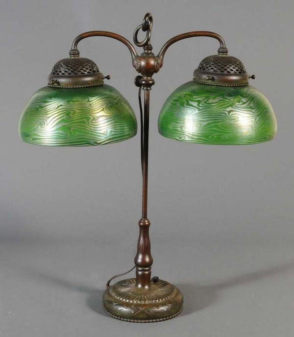 32: TIFFANY STUDIOS DOUBLE STUDENT LAMP with two matchi