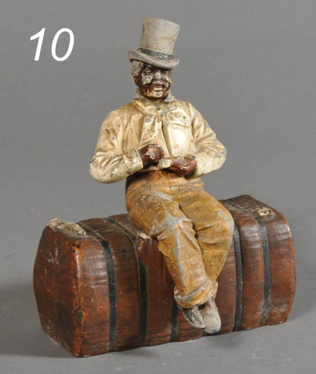 10: BLACK MAN DOORSTOP with top hat and cigar, sitting