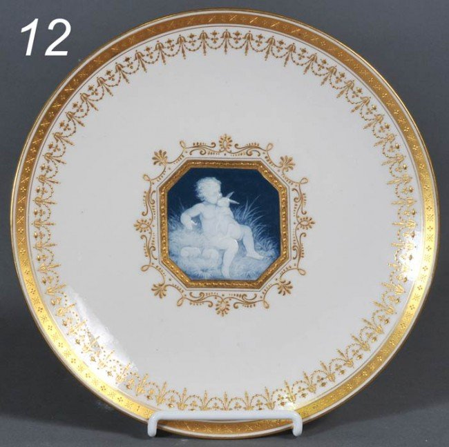 12: MINTON PATE-SUR-PATE PLATE decorated with a cherub