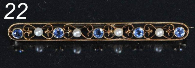22: SAPPHIRE AND SEED PEARL BAR PIN SET IN 14KT GOLD 63