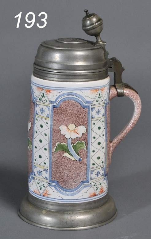 193: DUTCH FAIENCE TANKARD with floral decoration 18th