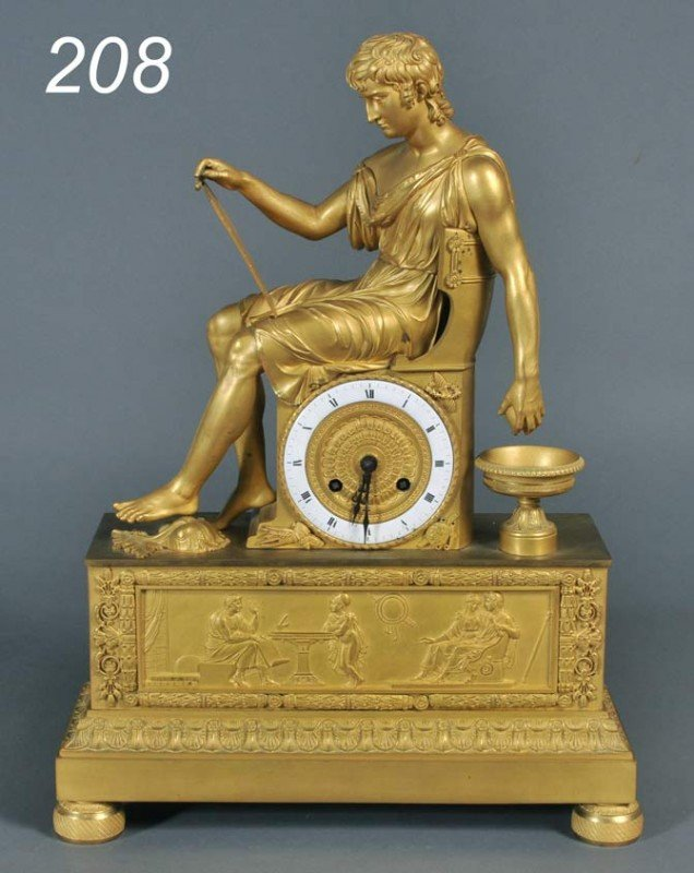 208: FRENCH EMPIRE GILT BRONZE MANTLE CLOCK depicting t