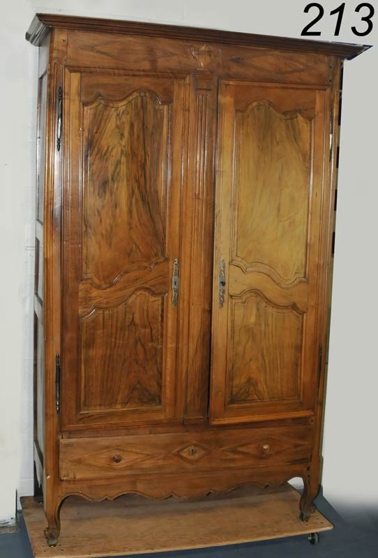 213: FRENCH PROVINCIAL WALNUT ARMOIRE with carved urn i