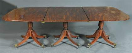 193 REGENCY MAHOGANY TRIPLE PEDESTAL DINING TABLE with