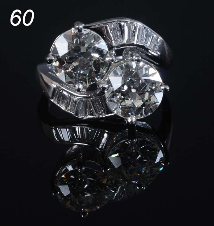 60: PLATINUM DIAMOND RING set with twin diamonds, appro