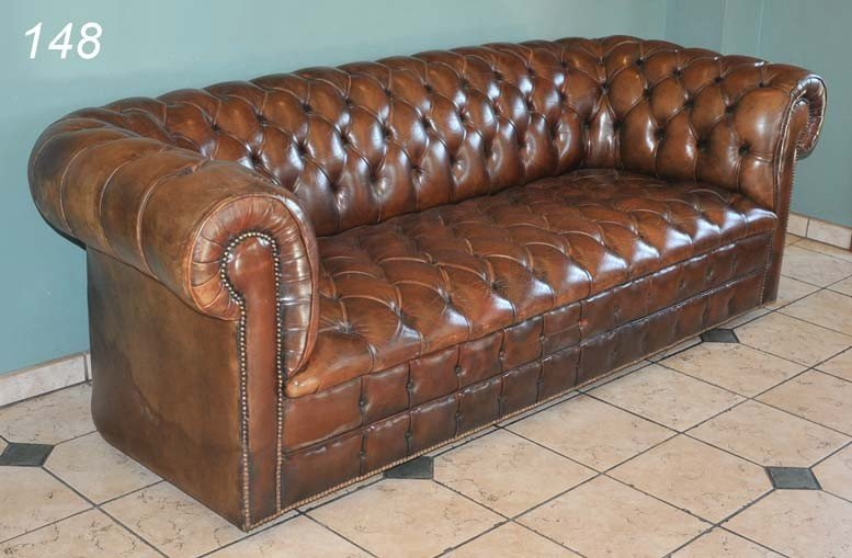 "148: BROWN LEATHER CHESTERFIELD TUFTED SOFA 77"" long at"