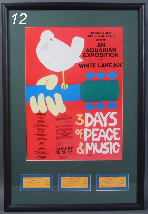 12: WOODSTOCK POSTER autographed by Carlos Santana fram