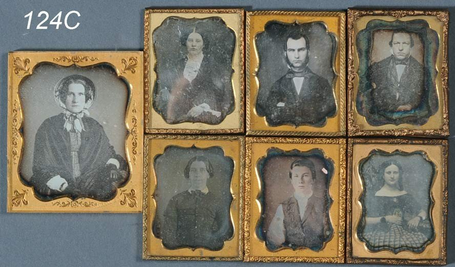 124C: FAMILY GROUP OF SEVEN CASED DAGUERROTYPES, larges