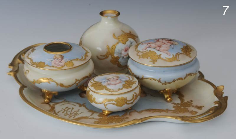 7: LIMOGES DRESSER SET paint decorated with cherubs con