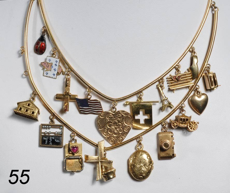 55: CHARM NECKLACE 14k gold with mechanical abacus, mou