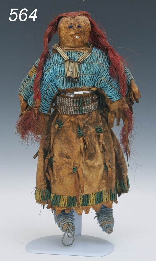 564: EARLY SIOUX DOLL with beadwork and quill breast pl