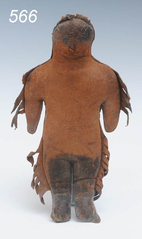 566: NATIVE AMERICAN LEATHER DOLL with fringe and paint