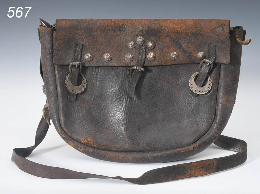 567: NAVAJO LEATHER SILVER MOUNTED BANDOLIER BAG with a