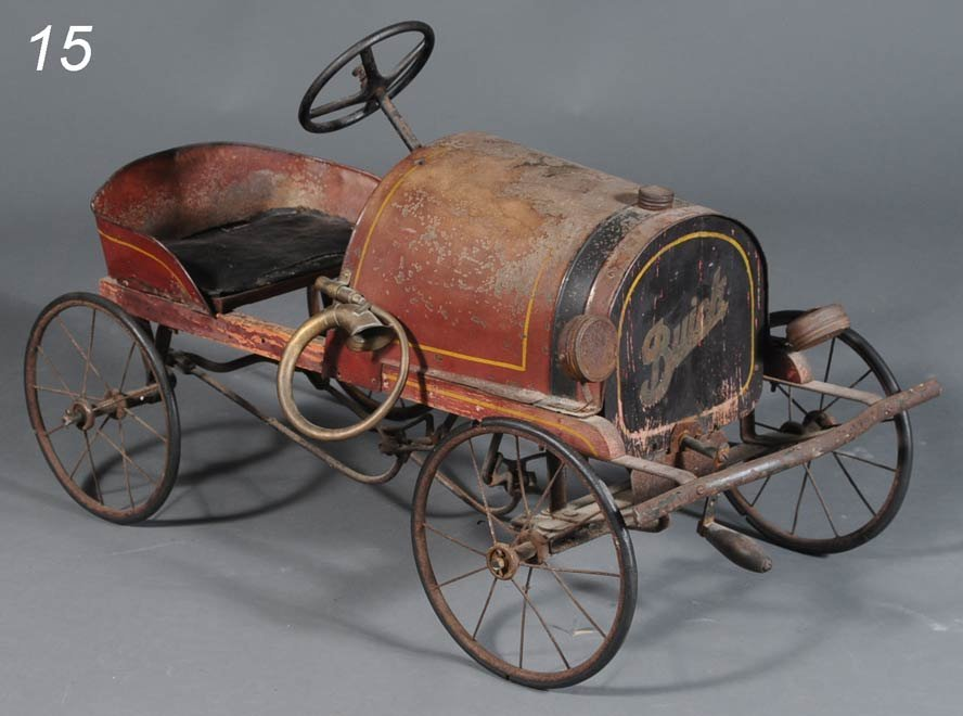 15: GENDRON WIRE SPOKE PEDAL CAR with Buick logo on gri
