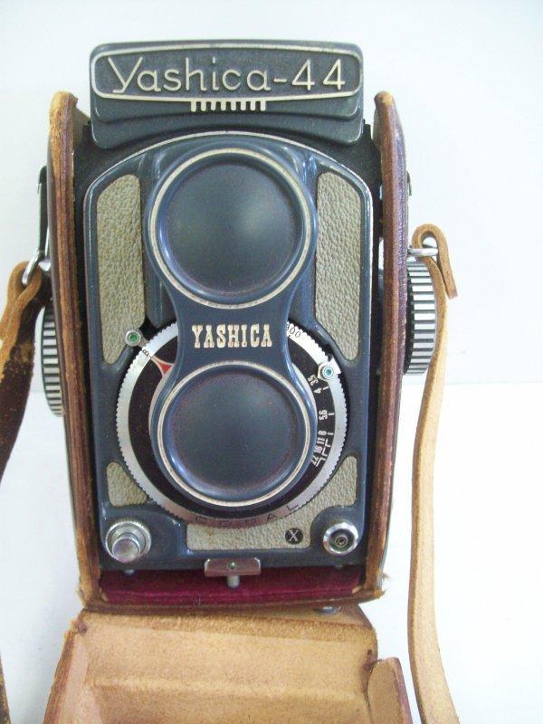 14: YASHICA-44 CAMERA & CASE. WEAR TO CASE.