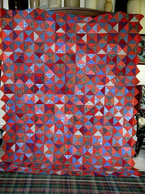 2488524: Blue And Red Triangles Scrap Quilt, Double