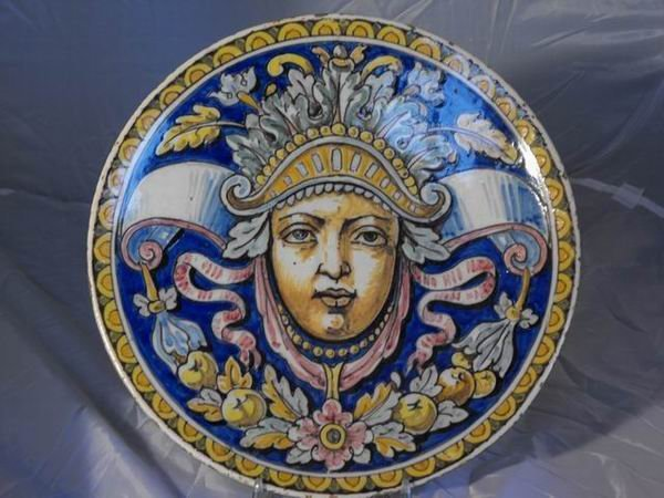 177: Plate with face