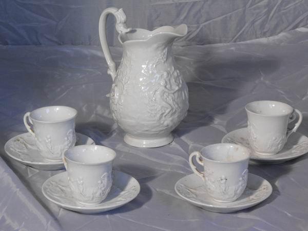 244: Four cups plus milk jug