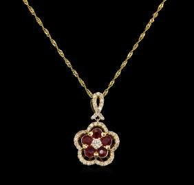 0.82 ctw Ruby and Diamond Pendant With Chain - 14KT