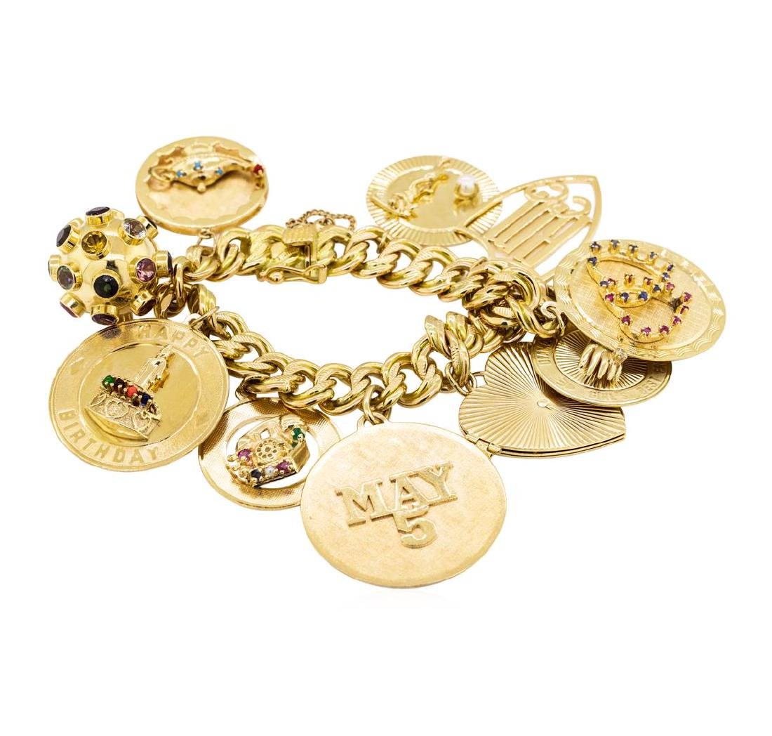 Charm Bracelet with Ten Attached Charms - 14KT Yellow