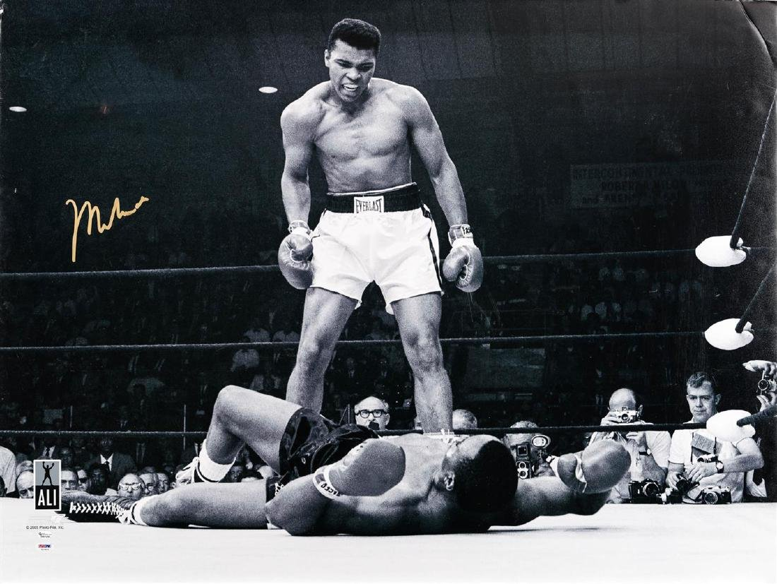 Muhammad Ali Standing Over Joe Frazier II - Black and