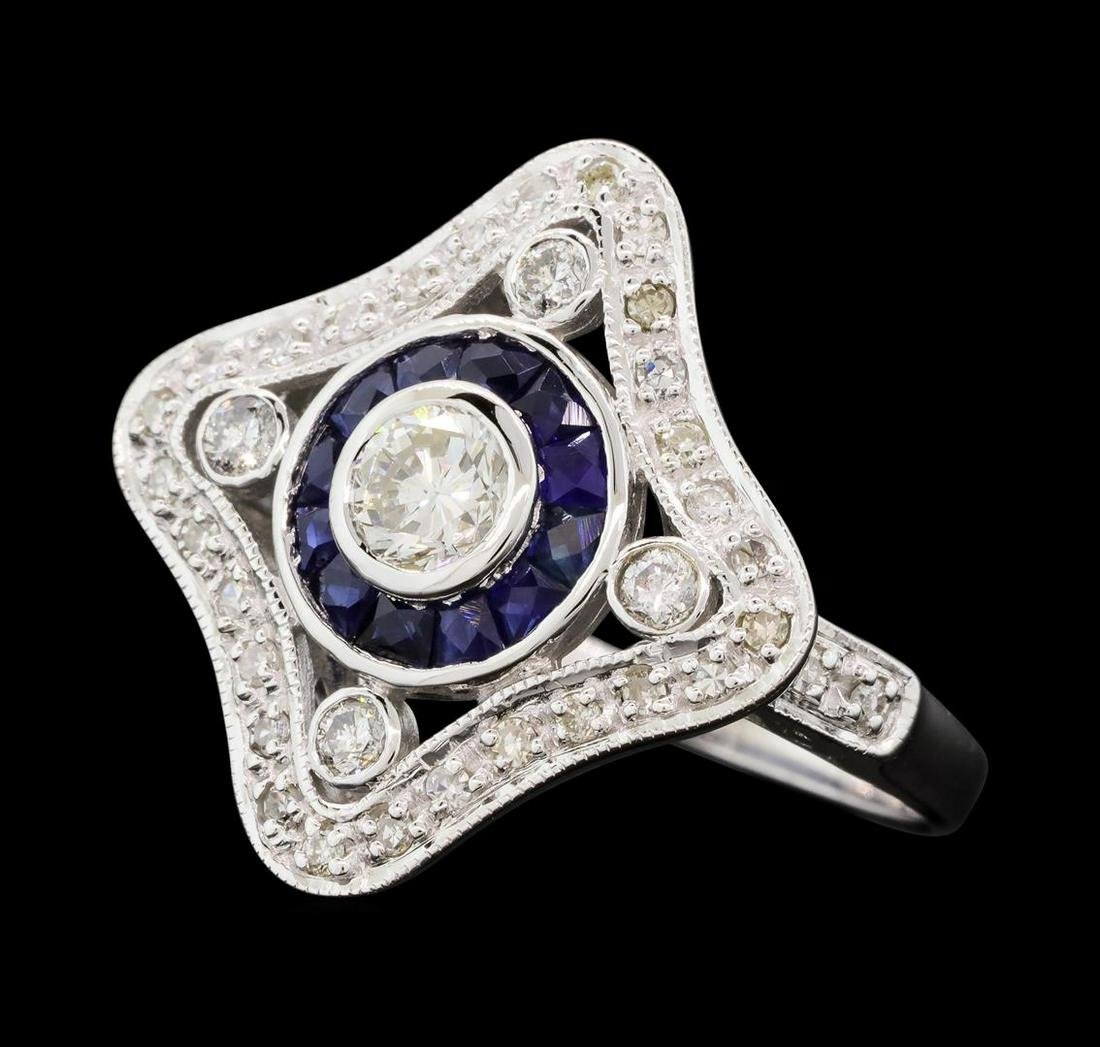 0.76 ctw Diamond Ring And Sapphire Ring- 18KT White
