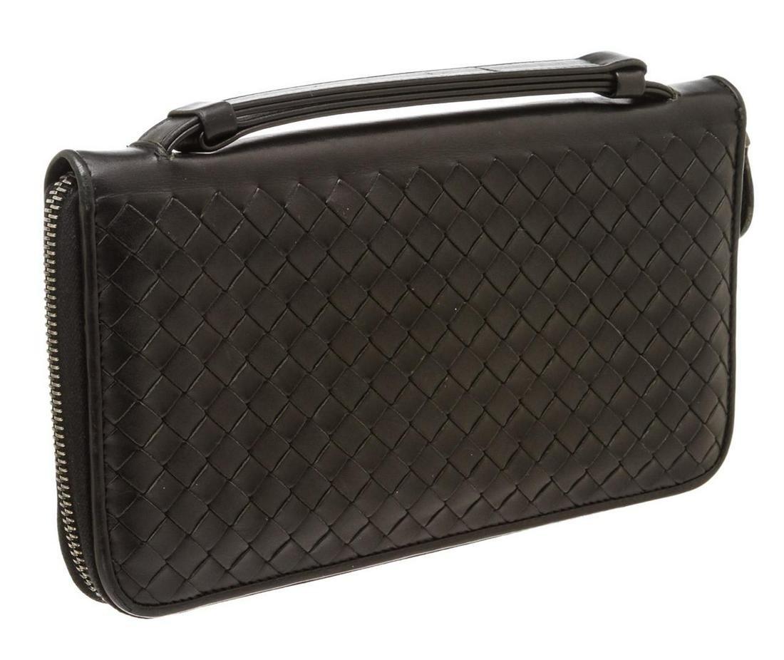 Bottega Veneta Black Woven Leather Large Zippy Wallet.