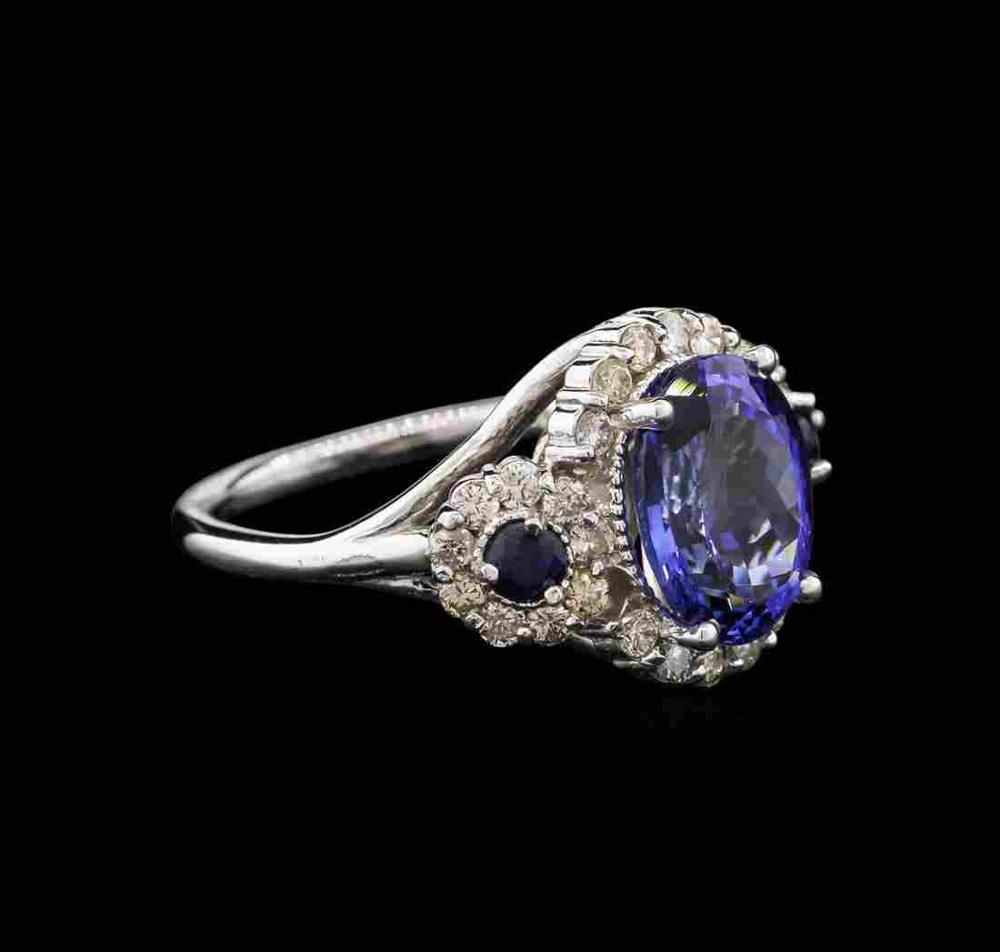 3.81 ctw Tanzanite, Blue Sapphire, and Diamond Ring -