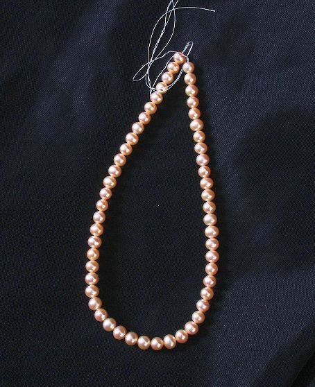 13: Loose Strand Cultured Light Coral Pearls 7.5-8mm ap