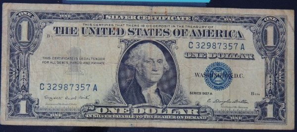 1: 1957 $1.00 Washington Silver Certificate PM1104