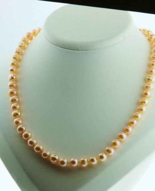 21: Necklace Strand Cultured Coral Pearls with silver c