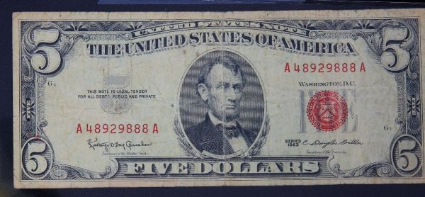 23: 1963 $5.00 Lincoln Red Seal Bill PM1010