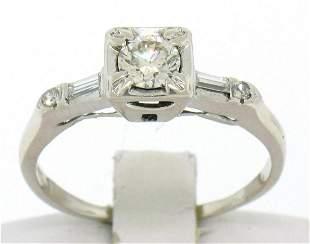 18k White Gold Round & Baguette VVS Diamond Engagement