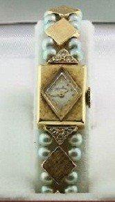 Ladies 14KT Gold Lucien Piccard Wristwatch. A864