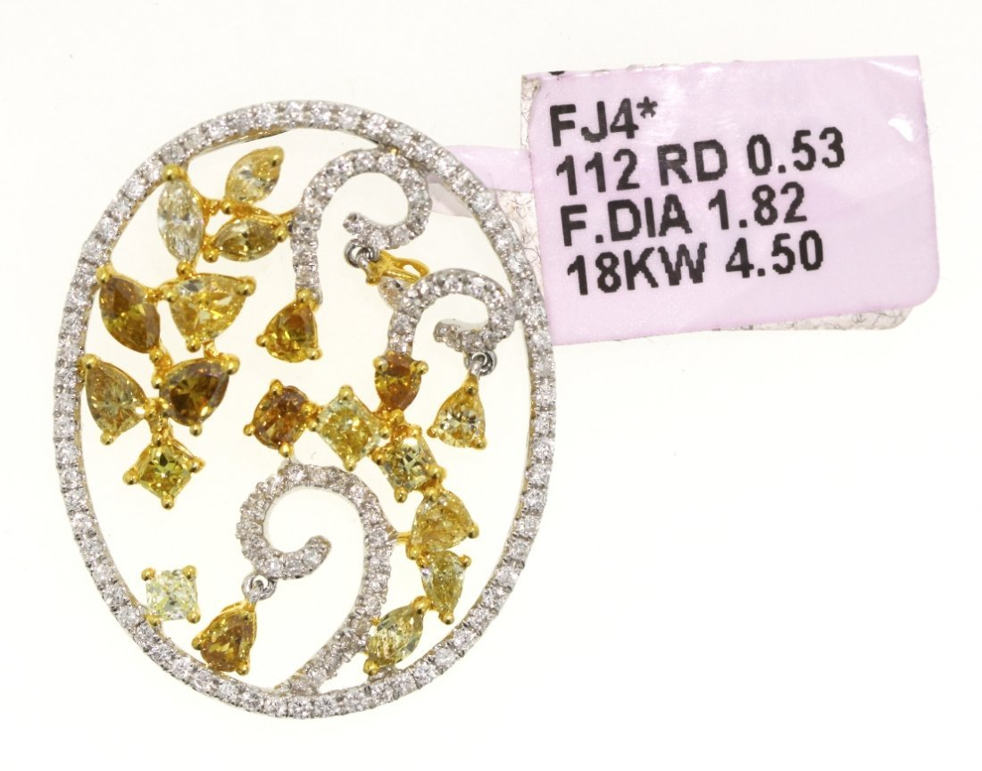 Beautiful 18KT White Gold Yellow and White Diamond Pend
