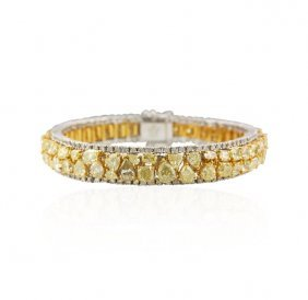 18KT Yellow & White Gold 20.79ctw Fancy Yellow Diamond