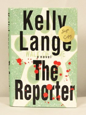 """Autographed Copy of """"The Reporter"""" BK145"""