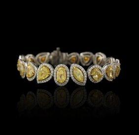 18KT Yellow & White Gold 24.59ctw Fancy Yellow Diamond