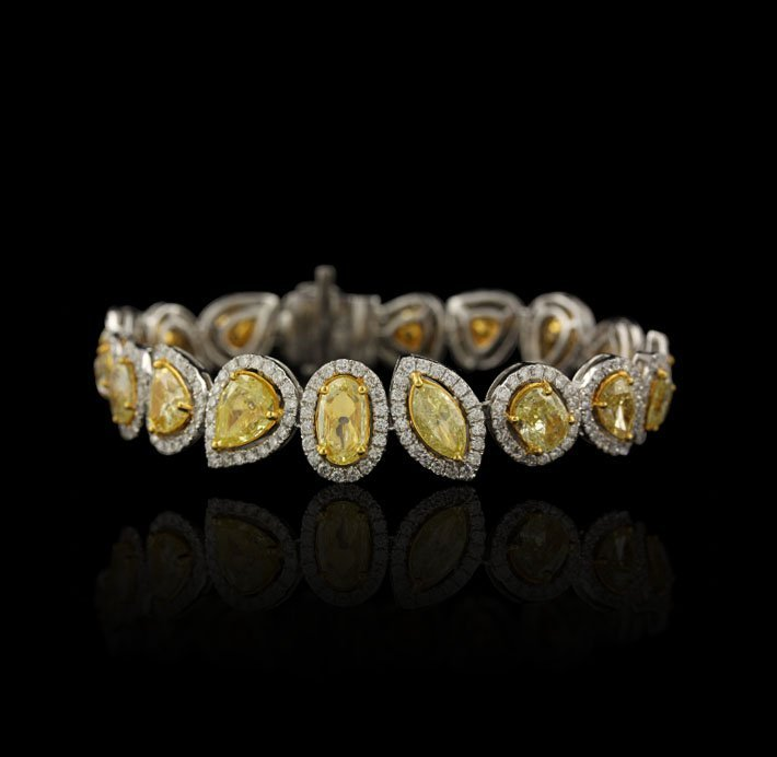 18KT Yellow & White Gold 24.59ctw Fancy Yellow Diamond
