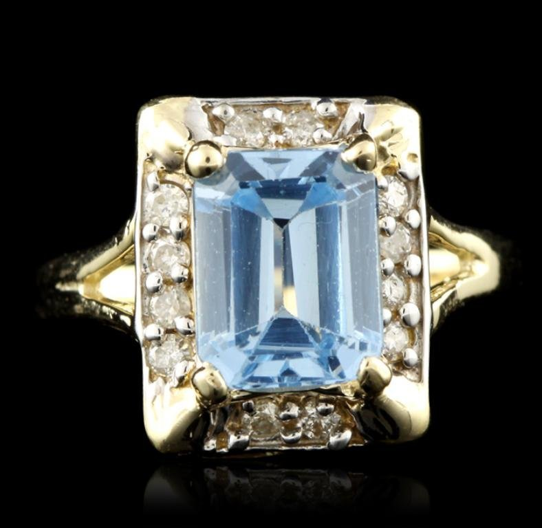 14KT Yellow Gold 2.70ct Blue Topaz and Diamond Ring