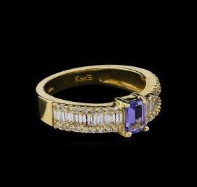 0.55ct Tanzanite And Diamond Ring - 14kt Yellow Gold